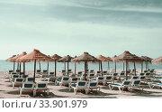 Parasols with deckchairs on the beach. Nerja, Spain (2013 год). Стоковое фото, фотограф Alexander Tihonovs / Фотобанк Лори