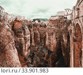 Amazing view of the Ronda canyon and the famous white village. Province of Malaga, Andalusia, Spain (2013 год). Стоковое фото, фотограф Alexander Tihonovs / Фотобанк Лори