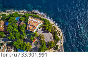 View directly from above coast and Mediterranean Sea. Summer luxury villas with swimming pools, parking area, sport tennis field. Mallorca or Majorca Island, Balearic Islands, España, Spain (2018 год). Стоковое фото, фотограф Alexander Tihonovs / Фотобанк Лори