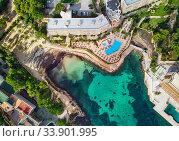 Drone point of view Cala Vinyes, green transparent water bay of Mediterranean Sea. Majorca, Espana, Spain (2018 год). Стоковое фото, фотограф Alexander Tihonovs / Фотобанк Лори