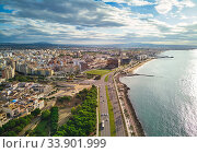 Aerial panorama Palma de Mallorca cityscape. Urban scene with roads along palm tree lined seafront tranquil Mediterranean Sea. Cloudy sky over townscape picturesque landscape. Balearic Islands, Spain (2018 год). Стоковое фото, фотограф Alexander Tihonovs / Фотобанк Лори