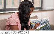 Купить «woman with diary sitting on sofa at home», видеоролик № 33902571, снято 24 мая 2020 г. (c) Syda Productions / Фотобанк Лори