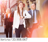 Купить «Confident businesswoman checking time on street», фото № 33908067, снято 25 марта 2019 г. (c) Яков Филимонов / Фотобанк Лори