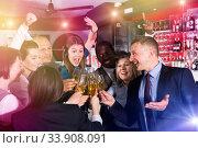 Jolly males and females clinking glasses. Стоковое фото, фотограф Яков Филимонов / Фотобанк Лори