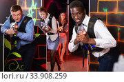 men and women co-workers having corporate entertainment. Стоковое фото, фотограф Яков Филимонов / Фотобанк Лори