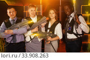 males and females in business suits posing at laser tag room. Стоковое фото, фотограф Яков Филимонов / Фотобанк Лори