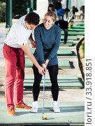 Купить «Woman and man golfers are enjoying game», фото № 33918851, снято 11 июля 2020 г. (c) Яков Филимонов / Фотобанк Лори