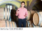 cheerful man posing in winery cellar. Стоковое фото, фотограф Яков Филимонов / Фотобанк Лори