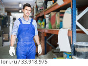 Worker in uniform standing on his workplace. Стоковое фото, фотограф Яков Филимонов / Фотобанк Лори