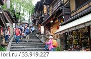 Купить «The view of stairs on Sanneizaka street full of cafe and souvenir shops near Kiyomizu-dera temple. Kyoto. Japan», видеоролик № 33919227, снято 27 апреля 2020 г. (c) Serg Zastavkin / Фотобанк Лори