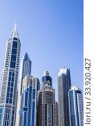 Купить «Dubai Internet City (DIC) is an information technology park created by the government of Dubai as a free economic zone and a strategic base for companies targeting regional emerging markets.», фото № 33920427, снято 15 февраля 2018 г. (c) age Fotostock / Фотобанк Лори