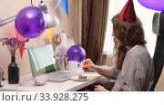 Купить «Woman celebrating birthday from home», видеоролик № 33928275, снято 19 апреля 2020 г. (c) Сергей Петерман / Фотобанк Лори