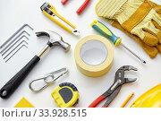 Купить «different work tools on white background», фото № 33928515, снято 26 ноября 2019 г. (c) Syda Productions / Фотобанк Лори