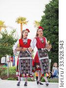 Купить «People in traditional folk Bulgarian costumes», фото № 33928943, снято 6 июля 2018 г. (c) Nataliia Zhekova / Фотобанк Лори
