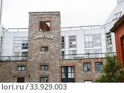 Купить «DUBLIN, IRELAND - JUNE 26, 2019: Entrance to the Old Jameson Distillery, Smithfield Square in Dublin, Ireland», фото № 33929003, снято 26 июня 2019 г. (c) Nataliia Zhekova / Фотобанк Лори