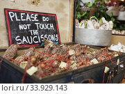LONDON - AUGUST 23, 2017: Saucissons on Borough market in London. Saucissons is large thick French sausages. Редакционное фото, фотограф Nataliia Zhekova / Фотобанк Лори