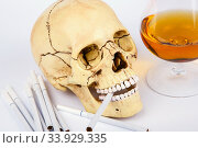Купить «Skull head with cigarettes and alcohol», фото № 33929335, снято 29 января 2016 г. (c) Nataliia Zhekova / Фотобанк Лори