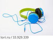 Купить «Headphones on a white background», фото № 33929339, снято 3 февраля 2016 г. (c) Nataliia Zhekova / Фотобанк Лори