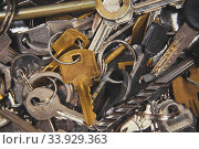 A Pile of old Keys different shapes and colors. Стоковое фото, фотограф Nataliia Zhekova / Фотобанк Лори