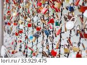 Купить «Closeup of love lockers at famous bridge Makartsteg in Salzburg, Austria. Padlocks of love on a bridge», фото № 33929475, снято 27 ноября 2018 г. (c) Nataliia Zhekova / Фотобанк Лори