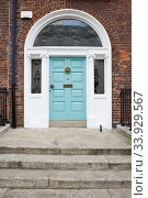 A blue door in Dublin, Ireland. Arched Georgian door house front. Стоковое фото, фотограф Nataliia Zhekova / Фотобанк Лори