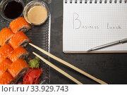 Купить «Sushi roll philadelphia in Disposable Plastic Food Container», фото № 33929743, снято 24 мая 2016 г. (c) Nataliia Zhekova / Фотобанк Лори