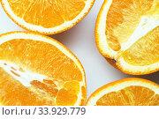 Купить «Four half juicy ripe orange isolated on white background», фото № 33929779, снято 26 января 2019 г. (c) Nataliia Zhekova / Фотобанк Лори