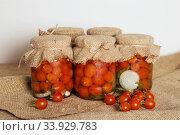 Купить «Transparent banks with marinated Cherry tomatoes», фото № 33929783, снято 26 августа 2016 г. (c) Nataliia Zhekova / Фотобанк Лори