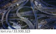 Купить «Aerial view of modern city highway grade separation in night lights», видеоролик № 33930323, снято 26 октября 2018 г. (c) Яков Филимонов / Фотобанк Лори