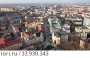 Aerial view of Rzeszow overlooking building of former monastery and Church of Holy Cross, Poland. Стоковое видео, видеограф Яков Филимонов / Фотобанк Лори