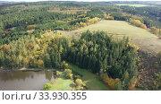 Купить «Picturesque autumn rural landscape with colorful trees by lake», видеоролик № 33930355, снято 16 октября 2019 г. (c) Яков Филимонов / Фотобанк Лори