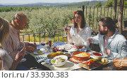 Friends having lunch on the open-air terrace. Стоковое видео, видеограф Яков Филимонов / Фотобанк Лори