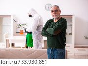 Young male sanitizer and old man indoors. Стоковое фото, фотограф Elnur / Фотобанк Лори