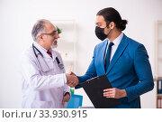 Купить «Young businessman meeting with old doctor», фото № 33930915, снято 4 февраля 2020 г. (c) Elnur / Фотобанк Лори