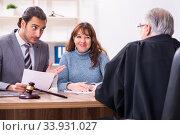 Купить «Young woman in courthouse with judge and lawyer», фото № 33931027, снято 25 ноября 2019 г. (c) Elnur / Фотобанк Лори