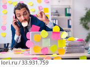 Купить «Young male employee in conflicting priorities concept», фото № 33931759, снято 4 октября 2019 г. (c) Elnur / Фотобанк Лори