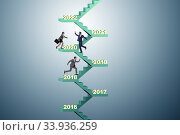 Businessman climbing stairs on yearly basis. Стоковое фото, фотограф Elnur / Фотобанк Лори
