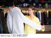 Woman choosing male overcoat. Стоковое фото, фотограф Яков Филимонов / Фотобанк Лори