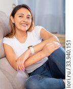 Купить «Young female relaxation at home on comfortable sofa», фото № 33940151, снято 15 июля 2020 г. (c) Яков Филимонов / Фотобанк Лори