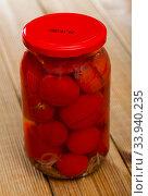 Glass jar with pickled tomatoes. Стоковое фото, фотограф Яков Филимонов / Фотобанк Лори