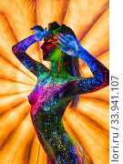 Girl with ultraviolet bodyart posing topless against bright umbrella. Стоковое фото, фотограф Гурьянов Андрей / Фотобанк Лори