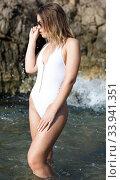 Купить «Sexy woman in swimsuit and sunglasses near stones at sea shore», фото № 33941351, снято 10 июля 2018 г. (c) Яков Филимонов / Фотобанк Лори