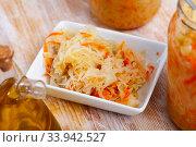 Sauerkraut in white plate. Стоковое фото, фотограф Яков Филимонов / Фотобанк Лори