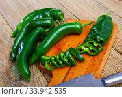 Купить «Green peppers with chopped slices», фото № 33942535, снято 11 июля 2020 г. (c) Яков Филимонов / Фотобанк Лори
