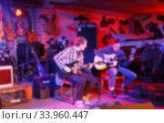 Купить «Musicians in a nightclub, blurred», фото № 33960447, снято 28 марта 2015 г. (c) Nataliia Zhekova / Фотобанк Лори