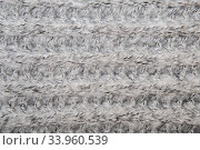 Gray melange fluffy woven thread sweater or scarf as a background. Стоковое фото, фотограф Nataliia Zhekova / Фотобанк Лори