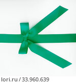green ribbon with bow on white background. Стоковое фото, фотограф Nataliia Zhekova / Фотобанк Лори