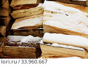 Купить «Wood pieces, tree chops stored outdoors for fireplace or mantel, texture or background.», фото № 33960667, снято 8 января 2016 г. (c) Nataliia Zhekova / Фотобанк Лори