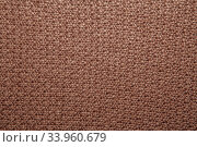 Seed stitch in brown yarn as an abstract background texture. Стоковое фото, фотограф Nataliia Zhekova / Фотобанк Лори