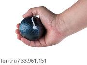 Купить «Toy bomb in a male hand on a white background closeup isolated», фото № 33961151, снято 8 апреля 2017 г. (c) Константин Лабунский / Фотобанк Лори